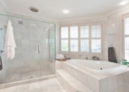 modern and contemporary en suite with white tub and glass enclosure   Rockingham Bathroom Renovations